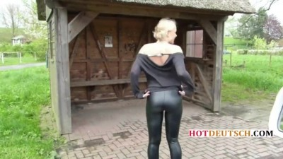 German car is hitchhiking in leather tights